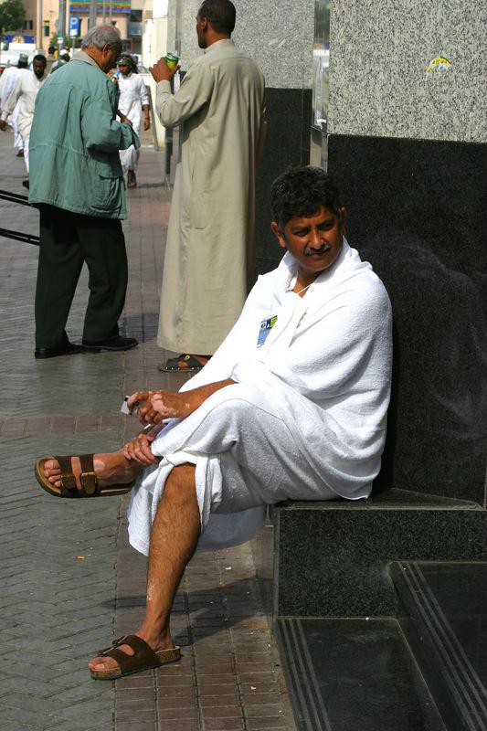 A Hajji waiting outside the hotel.