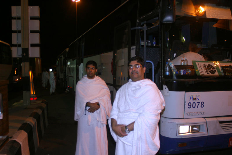At one of the rest stops.  The Rajput men waiting by the bus.  By nightime, the Ihrams would be well draped because it would get cold.