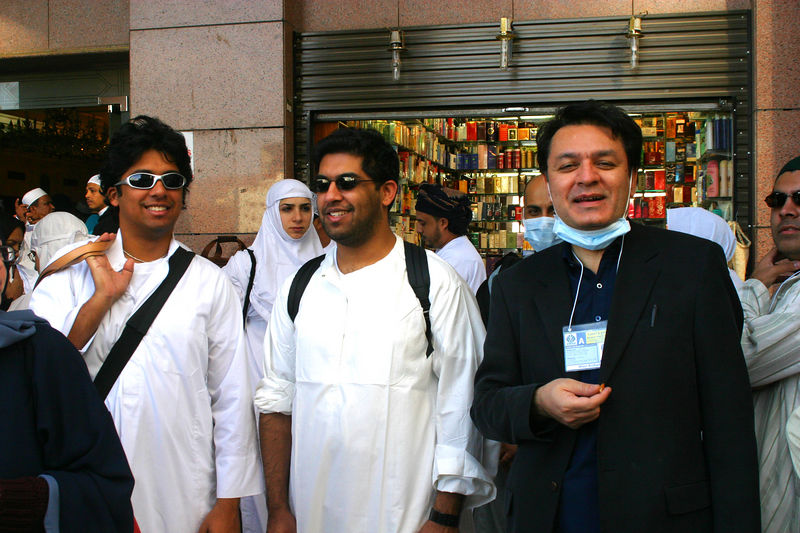 The three cool Hajis in front of our interim hotel.  Arshad kept a mask on most of the time, and first I pooh pooed it, but after hearing the symphony of coughs, I rapidly took up his offer of masks.