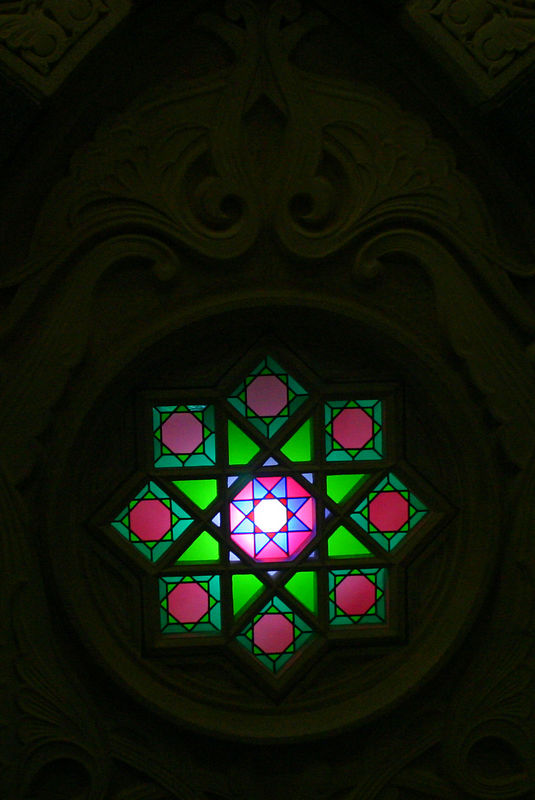 One of the stained glass windows in the masjid.