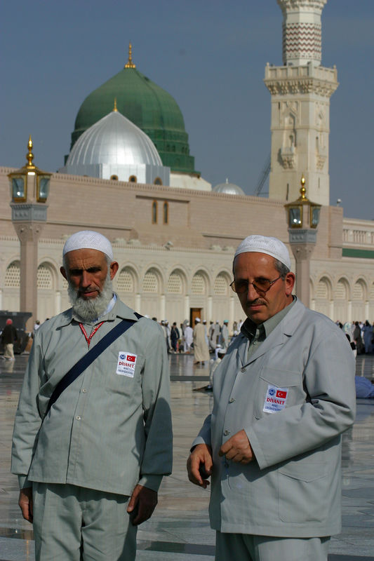 Two turkish hajis.  They were always friendly and greeted you in the mosque if you were next to them.  The men all wore the same grey pinstriped pants and jackets with the turkish haj emblem on the chest.