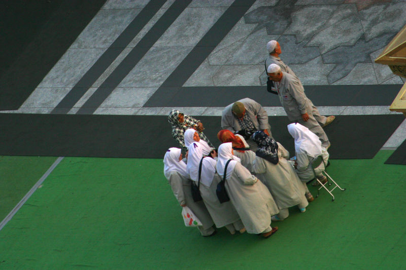 Turkish Hajis collecting together.  They were easy to identify by their clothes.  I found the men to be very friendly.
