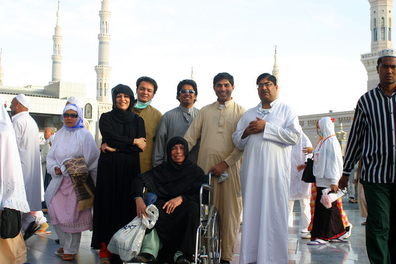 The group.  LtoR: Ambreen(standing in black), Arshad Jan, Ash, me and Dr. Rajput.  Mummy is in a wheelchair that was acquired by Ambreen.  I really liked how she got things done.  She spotted the chair which are there for use in the mosque(at least we think!), and she nabbed it since Mummy was feeling pretty tired.  She also got Mummy the new updated head dress which was much easier to put on.  In all fairness, this Haj would have been difficult for Mummy without her.