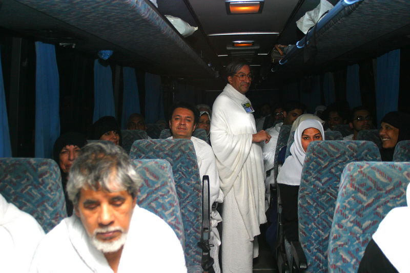 Dr. Riaz talking with everyone on the bus.  Behind him are Arshad, Ambreen and Mummy.