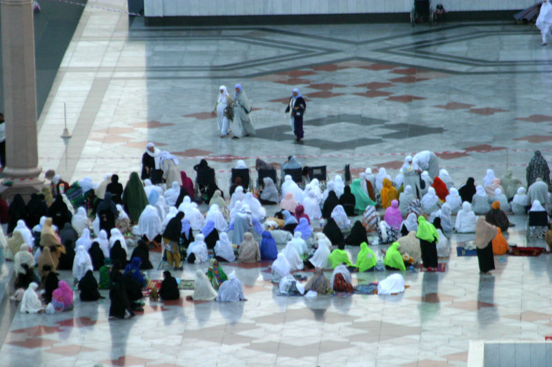 Part of the courtyard where women have congregated for prayers.