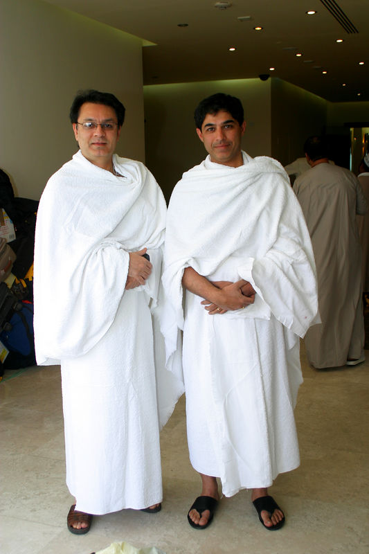 Arshad and me in our Ihrams.  Male pilgrims have to wear two pieces of unstitched cloth.  As you can see, Arshad looks very well put together.  He has had some practice with a blanket that pathan men usually wrap themselves in.  We are waiting for our bus to take us to Makkah.