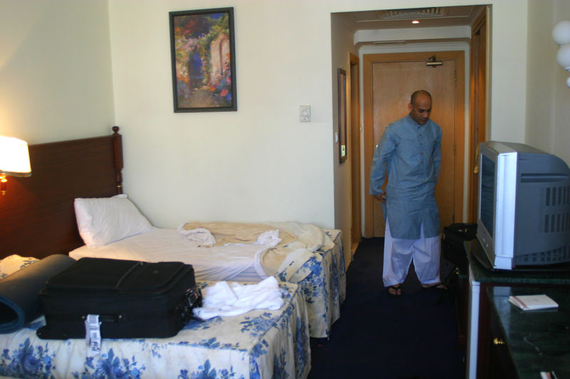 Our first hotel was only for 7 hours because we could not check into the Movenpick when our flight landed.  We quickly changed and made it to the Fajr (dawn) prayers.  Since  we were so rushed, we forgot Mummy's chair and she had improvise.  THe hotel room had four beds, and all the men took one room and the women the other.  Nadeem as usual was dressed impeccably with starched clothes.
