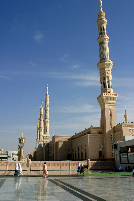 The slender minarets that surround the mosque.