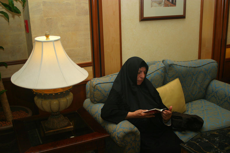 Mummy reading the Quran in the hotel.