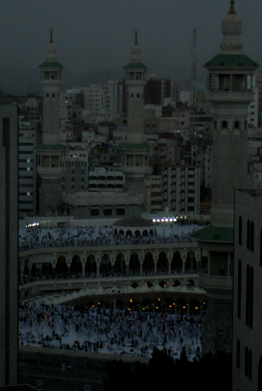 We reached Makkah at dawn.  This is the view from the hotel room.  You can only see the top floor of the Haram Sharif Masjid.  You cannot see the Kaaba since it is on the ground floor and to the right.  Even at this time there are lots of people around.  The crowds only got bigger.