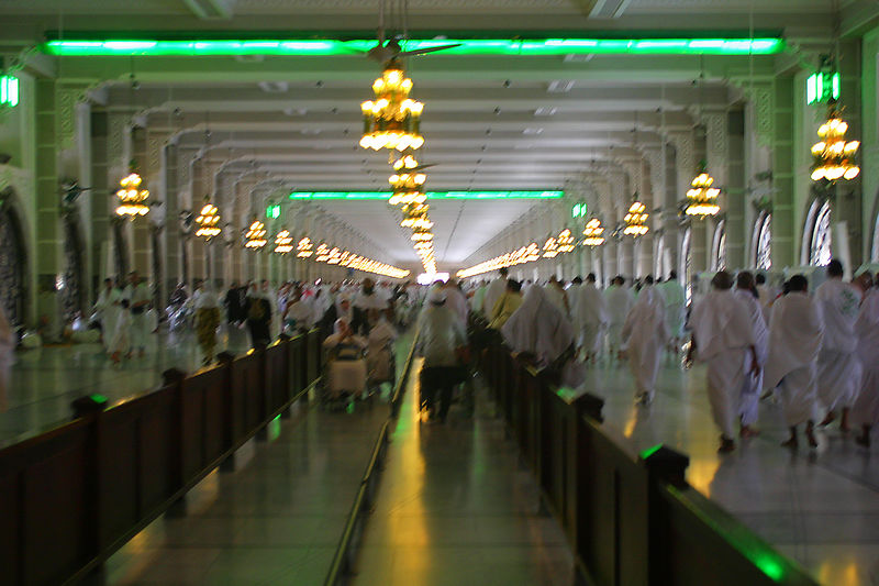 After the seven rounds of the Kaaba, you offer prayers by the Muqam-Ibrahim, get zam-zam water and then go between the hills of Safa and Marwa seven times.  The hills are no more than circular chambers at the end of the long corridors.  The center of the corridors are for wheelchairs only.  Between the two set of green lights, the Hajjis are supposed to walk briskly or jog in the same manner as Hajira, Prophet Abraham's wife who ran distraught between the hills in search of water.  In the valley she sped up since she could not see her infant son who lay on the ground.