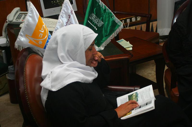 Zahida reading in the lobby.