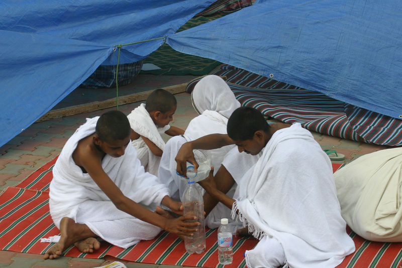 The non-registered Hajis had set up temporary shelter in every square foot of the road.