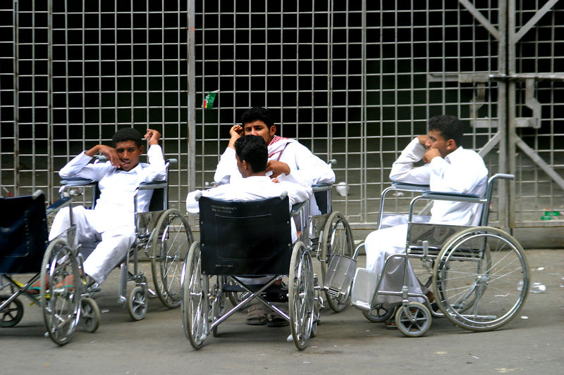 The wheelchair pushers waiting for a ride.