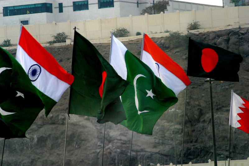 Flags from many differnt nations together...Pakistan, India and Bangadesh.