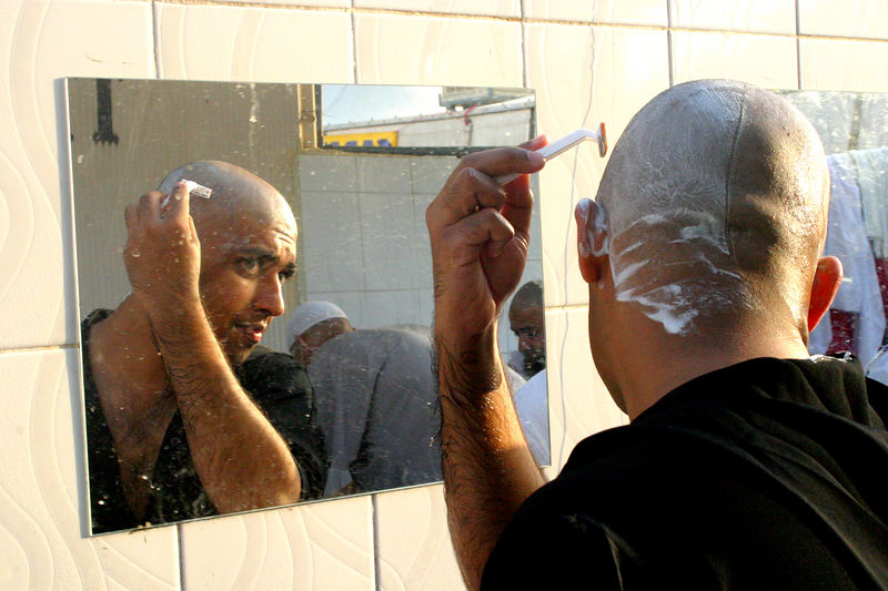 Zeshan using the rest area to clean up his shave.