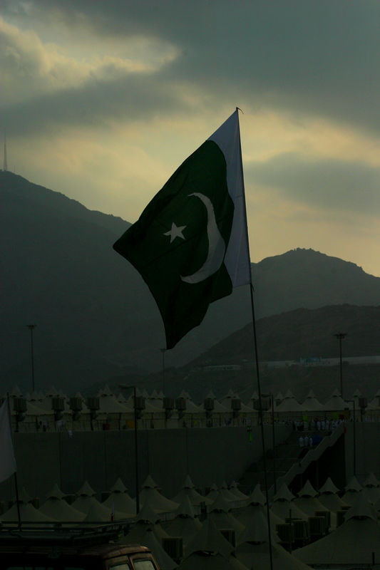 I love this picture of the Pakistani flag flying at dawn.