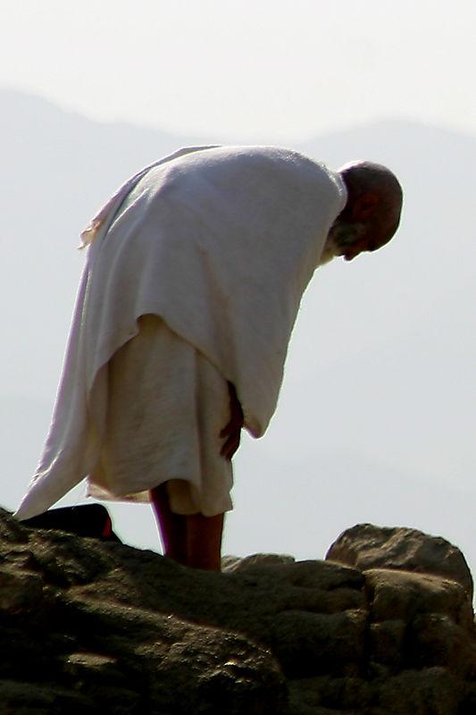 A Hajji praying on the mountain.