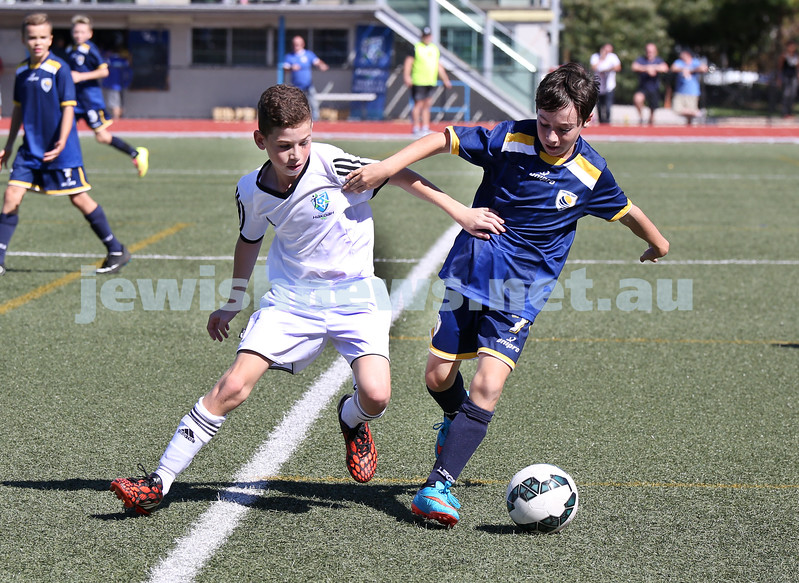 U12 Soccer at Hensley Athletic Field. Hakoah (white) vs Central Coast (blue).