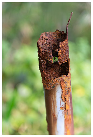 Part of an old fence post.  The sulfur is corrosive to iron and steel too.
