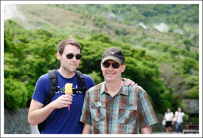 Jake and Chris at Owakudani.  Jake is eating a boiled egg ice cream.