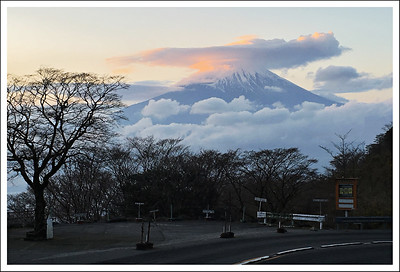 On the way back, we walked on the service road for the communications tower save time.  I waited for Seishi at the entrance to the main road while he walked on the busy road back to the parking lot.  While waiting, I captured this image of Fuji.  I used digital zoom on my phone, so the image is noisy and not clear.