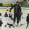 Former Boston Bruin and NHL veteran Hal Gill instructs participants of the Little Bruins Youth Hockey Program at the Gaetz Arena at Wallace Civic Center. SENTINEL&ENTERPRISE/ Jim Marabello