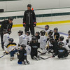 A local youth hockey coach instructs participants in the Little Bruins Youth Hockey Program at the Gaetz Arena at Wallace Civic Center as former Bruin and NHLer Hal Gill looks on. SENTINEL&ENTERPRISE/ Jim Marabello