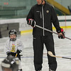 Former Boston Bruin and NHL veteran Hal Gill instructs a participant of the Little Bruins Youth Hockey Program at the Gaetz Arena at Wallace Civic Center. SENTINEL&ENTERPRISE/ Jim Marabello