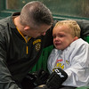 A young participant of the Little Bruins Youth Hockey Program at the Gaetz Arena at Wallace Civic Center is a little reluctant to go back onto the ice despite encouragement from his father. SENTINEL&ENTERPRISE/ Jim Marabello