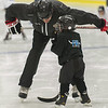 Former Boston Bruin and NHL veteran Hal Gill bends down, way down to instruct a participant of the Little Bruins Youth Hockey Program at the Gaetz Arena at Wallace Civic Center. SENTINEL&ENTERPRISE/ Jim Marabello