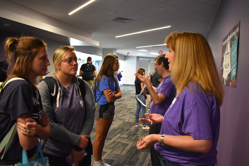 Laura Bonella, academic services librarian for social sciences and education, helped two students, Avery Mott and Hannah Meredith, juniors in elementary education, during the Meet Your Librarian event Bonella has been with K-State for 19 years. (Bailey Britton | Collegian Media Group)