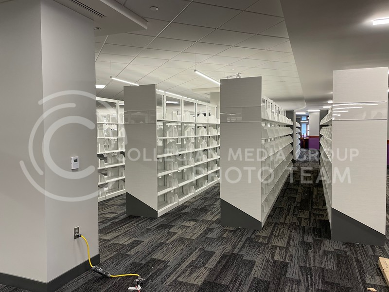 White shelves on the fifth floor of Hale Library stand empty, but books will soon return to fill the Special Collections section. (Bailey Britton   Collegian Media Group)