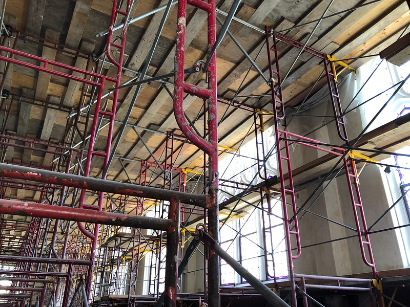 "Scaffolding clutters the space of Hale Library's Great Room, located on the third floor. Above, a walkway nicknamed the ""dance floor"" supports construction crew members working on the high ceiling. Photo taken on on May 17, 2019. (Dene Dryden 