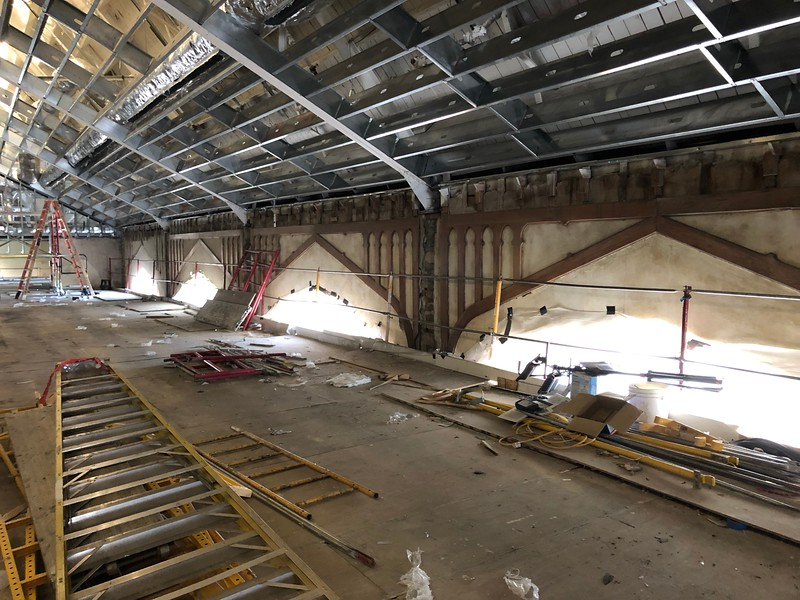 "Ladders and construction tools lay about on top of the ""dance floor"" in Hale Library's Great Room on May 17, 2019. (Dene Dryden 