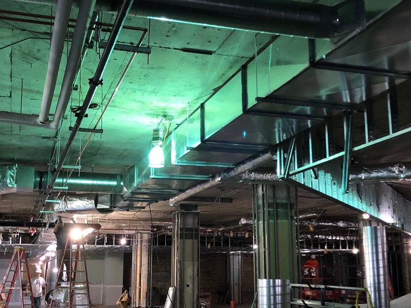 A temporary light glows on the ceiling of Hale Library's first floor on May 17, 2019. (Dene Dryden | Collegian Media Group)