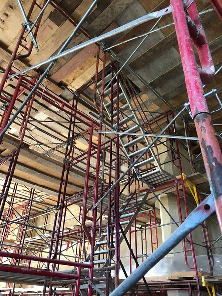 In the Great Room, lightweight metal stairs take construction crew members up to the raised platform to work on the ceiling. Photo taken on May 17, 2019. (Dene Dryden | Collegian Media Group)