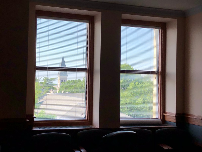 From a relatively untouched, fifth-floor conference room in Hale Library, the bell tower of Anderson Hall peeks through the window on May 17, 2019. (Dene Dryden | Collegian Media Group)
