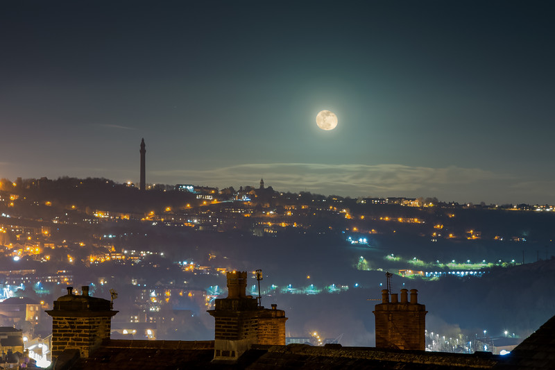 Wainhouse Tower and rooftops with full moon.