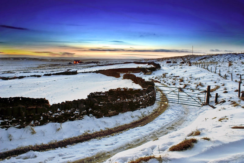 Wainstalls with snow at winter during twilight hours.