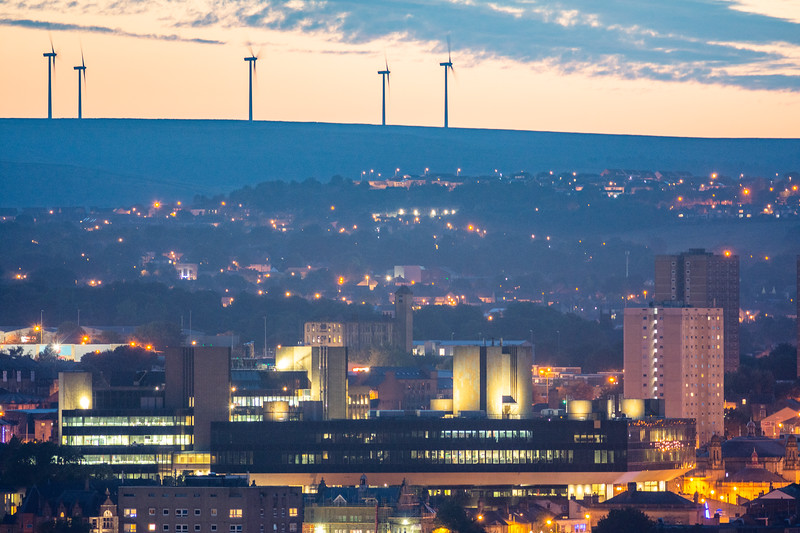 Lloyd's Bank (Halifax) and wind turbines at Sunset.