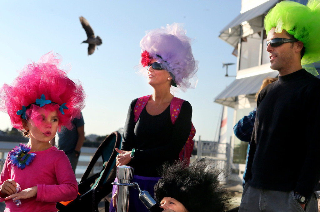 . It was a Halloween stroll for the trolls for Dominic and Maria Calmels and their children Molly and Martín on the Santa Cruz Municipal Wharf Tuesday.  (Shmuel Thaler -- Santa Cruz Sentinel)