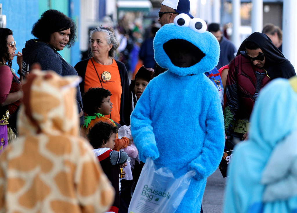 . No question what this fellow was hoping for in his treats bag during Halloween on the wharf. (Shmuel Thaler -- Santa Cruz Sentinel)