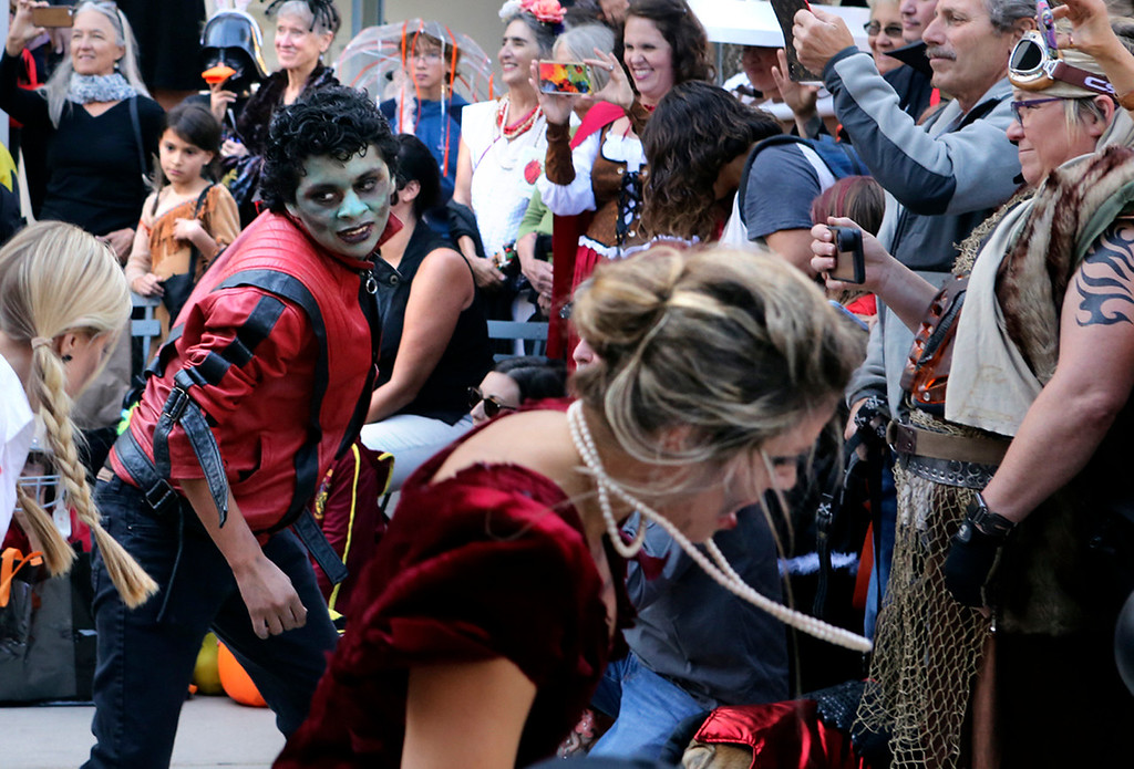 . Even Michael Jackson came back to life during he playing of \'Thriller� at the zombie flash mob thanks to the portrayal by Jacob Michael Rovegno, of Santa Cruz. (Shmuel Thaler -- Santa Cruz Sentinel)