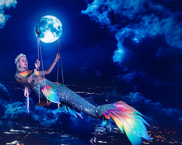 Mermaid swinging on the moon