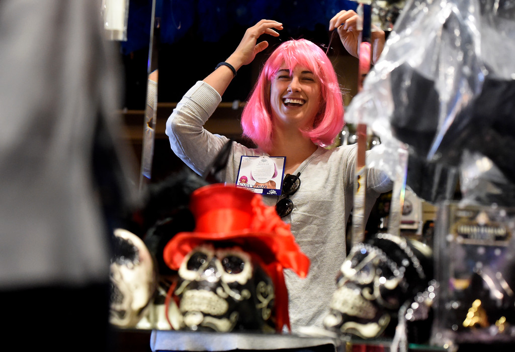 . Sarah Niemeyer laughs as she tries on a wig while shopping for a Halloween costume on Wednesday at The Ritz Costumes on Walnut Street in Boulder. For more photos of people shopping for costumes at The Ritz go to dailycamera.com Jeremy Papasso/ Staff Photographer 10/25/2017