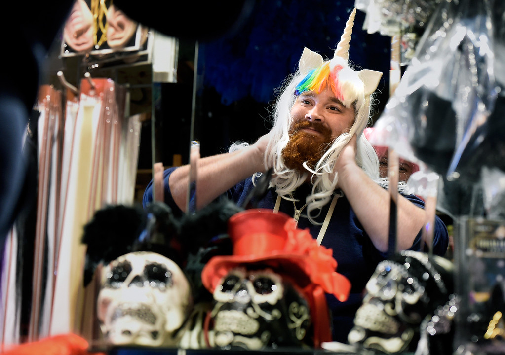 . Dylan Ham tries on a Unicorn wig while shopping for a Halloween costume on Wednesday at The Ritz Costumes on Walnut Street in Boulder. For more photos of people shopping for costumes at The Ritz go to dailycamera.com Jeremy Papasso/ Staff Photographer 10/25/2017
