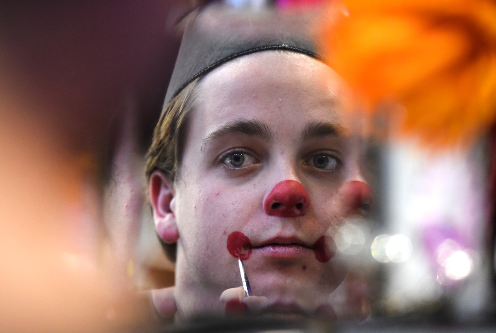 . Employee Topher Williams applies clown makeup for his costume on Wednesday at The Ritz Costumes on Walnut Street in Boulder. For more photos of people shopping for costumes at The Ritz go to dailycamera.com Jeremy Papasso/ Staff Photographer 10/25/2017