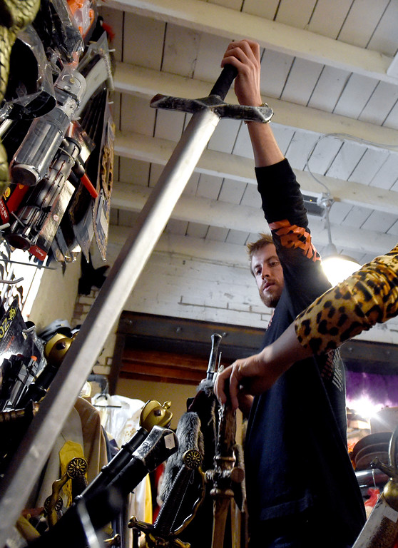 . Jerod Barker grabs a sword to go with his costume while shopping for a Halloween costume on Wednesday at The Ritz Costumes on Walnut Street in Boulder. For more photos of people shopping for costumes at The Ritz go to dailycamera.com Jeremy Papasso/ Staff Photographer 10/25/2017