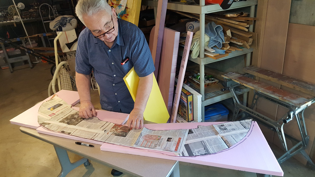 "Jerry Smith makes a newspaper template for the raised area for the back of the houses onto 1"" foam board"
